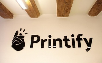 Photo of Print on demand company Printify has an ambition to become a USD 1 billion startup, the company's founder Janis Berdigans said during the opening of the new Printify building